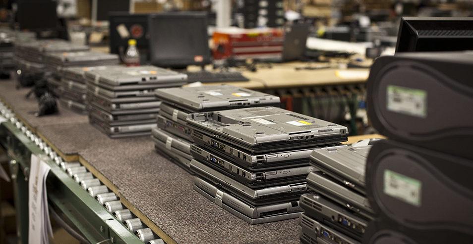 Stacks of returned laptops in audit